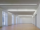 Empty gallery space with assorted lighting systems in the suspended ceiling (Goethe Institut, London)
