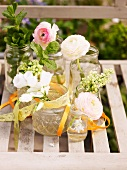 Spring flowers in old jam jars