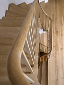 View from above into a modern, simple, oak stairway (Four Oaks Brick House in the Country)