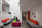Contemporary designer sofas and stools in the waiting area of a modern college (Oxford and Cherwell Valley College)