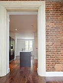 Minimalist designer kitchen behind a brick wall with tall doorways (Royal Military Academy, Woolwich)