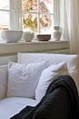 Cozy window area with white upholstered armchair and pillows