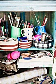 Assorted sewing and craft supplies in a old wooden cupboard