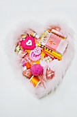 Assorted sewing and craft supplies in a heart shape