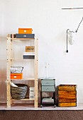 Plain storage shelving and cabinet on castors next to vintage crates