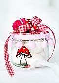 Screw top jar decorated with a hand painted toadstool