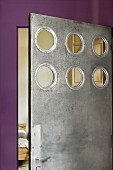 Steel bedroom door with circular cut-outs