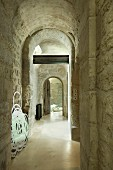Hallway with barrel vaulted ceiling and limestone walls