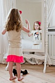 Young girl posing in front a of a mirror