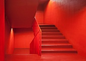 Vibrant red, monochrome staircase