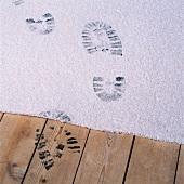 Black footprints on a carpet