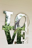The word 'Love' in mirrored letters as well decoration