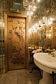 Door painted with Chinese motif in ensuite bathroom with mirrored ceiling and walls