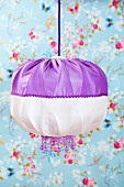 Hand-crafted pendant lamp with purple and white lampshade