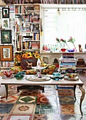 Eccentric collection of books, Murano glass vessels and floor tiles with various motifs