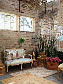 Vintage rugs in front of Rococo bench in corner of loft-style interior with brick walls