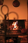A atmospheric fire in an old brick fireplace