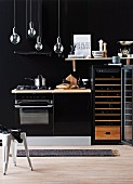 Kitchenette against black wall