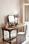 Nostalgic dressing table with mirror on top and various perfume bottles