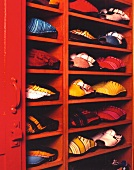 A shoe cupboard made from red-painted wood