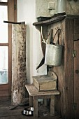 Wooden stool, cleaning utensils & tools in rustic interior