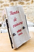 Nostalgic cookery book bound in linen with embroidered title