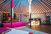 Interior of Mongolian yurt with strong sunlight falling through roof
