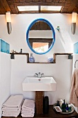 Rustic washstand and oval mirror in bathroom