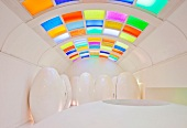 Designer toilet with vaulted ceiling and coloured glass elements in ceiling