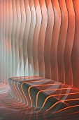 Slits backlit with coloured light in amorphous wall with integrated bench