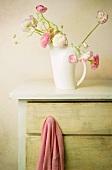 Ranunculus in white jug