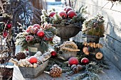 A Christmas terrace arrangements with frozen roses, twigs and pine