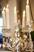 Crystal candlestick with lit candles