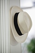 White summer hat hanging on peg