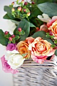 Bouquet of roses in white wicker basket