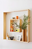 Different sized wooden frames as a pretty wall shelf