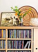 Bouquet on modern cabinet with integrated CD shelves