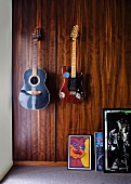 Wood-clad wall with vintage guitars hanging on it