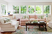 Comfortable living room with luxurious, upholstered seating in romantic, English country-house style