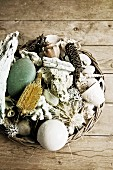 Basket of beach finds on wooden surface
