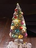 A small artificial decorative Christmas tree