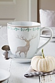 Place setting with ornamental gourd and hunting motif on cup