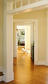 Home Interior; West Highland Terrier On Wood Floors