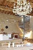 Loft-style interior in tower with wood-beamed ceiling & industrial staircase in Chateau Maignaut (the Pyrenees, France)