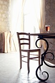 Dining table with wrought iron frame in interior of Chateau Maignaut (Pyrenees, France)
