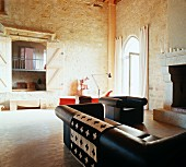 Interior with sofa set & open fireplace in Château Maignaut (Pyrenees, France)