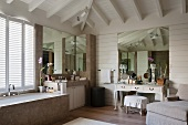 Spacious, luxurious bathroom with recamier and dressing table
