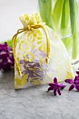 Small bag filled with hyacinth florets