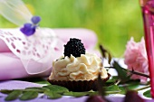 Blackberry tartlet on summer table