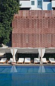 Luxurious swimming pool and loungers in Raas Haveli Hotel, Jodhpur, India
